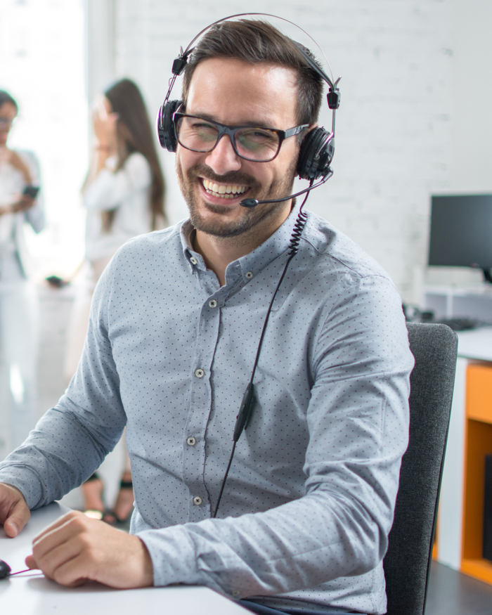 young male customer support executive working in office