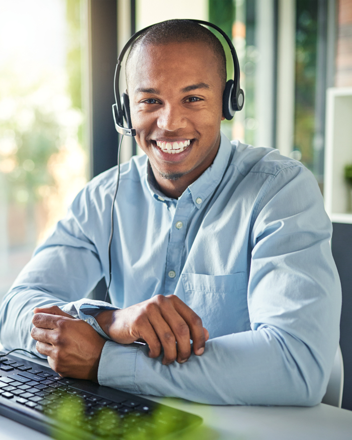 image of a male customer support agent working